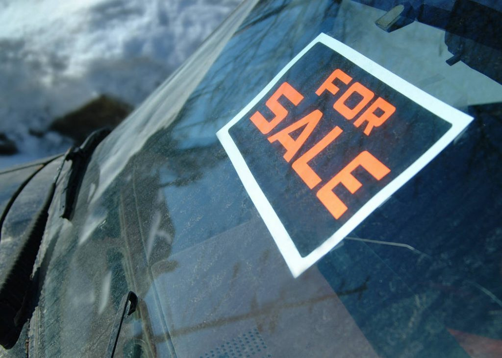 For Sale Sign in Windshield