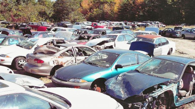 salvage cars in field