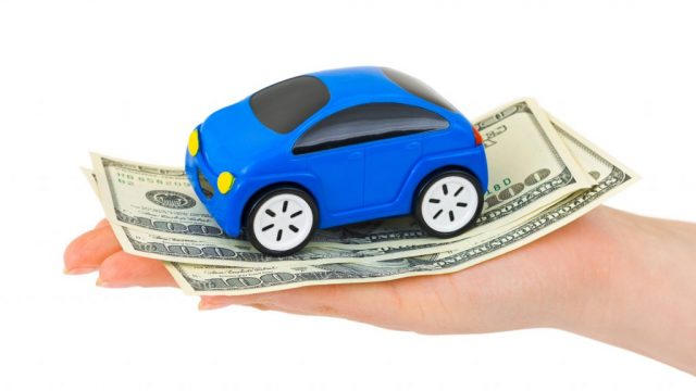 toy car on dollars
